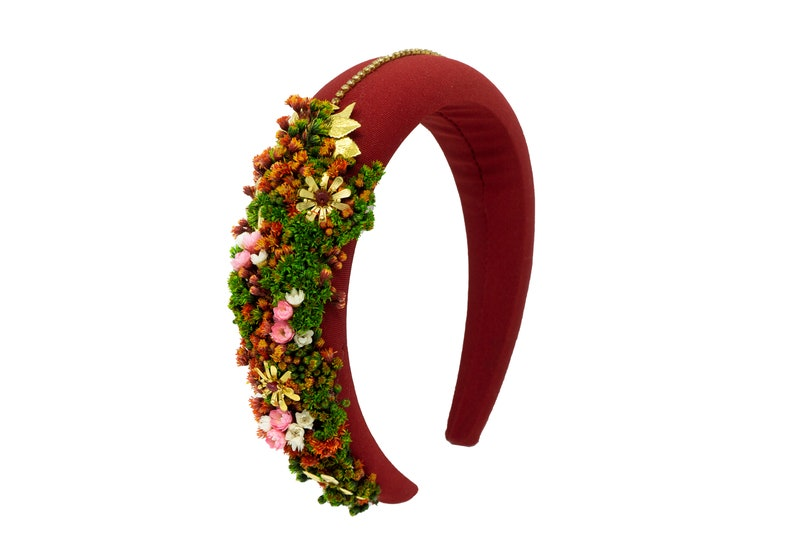Contact us to customize yours! Red halo headband made by hand and decorated with a variety of flowers and jewel pieces