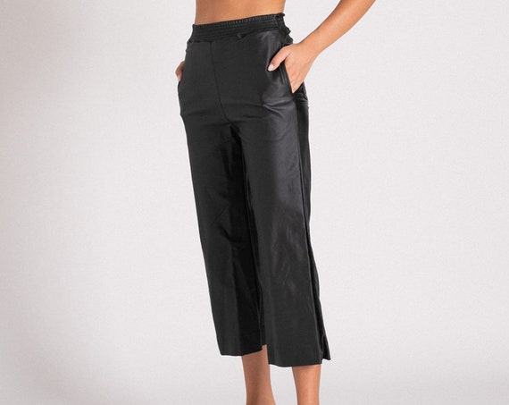 High waisted Black Faux Leather Karate fit Pants.