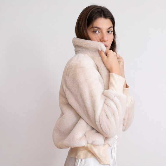 Bohemian Fluffy Bomber faux-fur coat in ivory color.