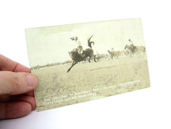 Vintage Rodeo Real Photo Postcard. Airborne Cowboy Dan Wallace on Bucking Horse, Cheyenne WY. R R Doubleday, 1920s