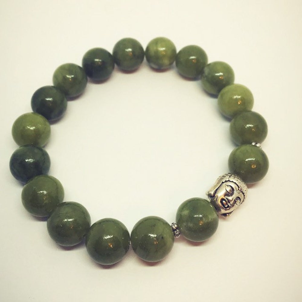 Jade Bracelet with Buddha image 0