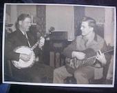 Photo of Vintage instruments playing vintage 30s 40s Banjo Unusual Guitar