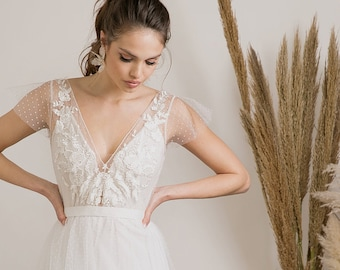 Graceful and delicate show stopping boho wedding dress with dreamy combination of fabrics, heavenly silhouette & divine handmade embroidery