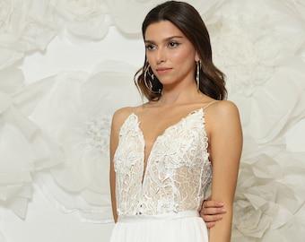 Breathtaking effortlessly beautiful bridal dress handmade from stunning combination of fabrics, feminine silhouette & flattering details.