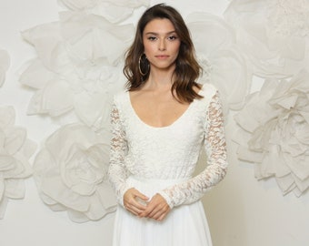 Simple wedding dress effortlessly beautiful and comfortable, long sleeve lace wedding dress with full circle lightweight skirt.