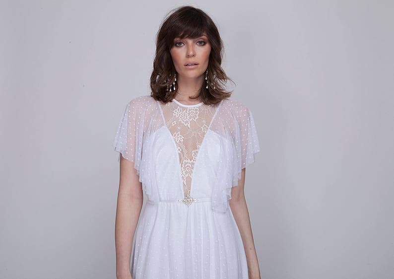wedding dress Lace wedding dress with mixed lace top and deep image 0