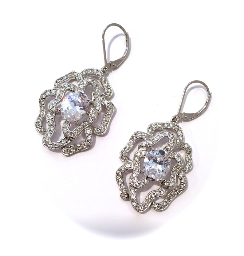 65185400a Vintage Sterling Silver Solitaire and Pave Estate Earrings   Etsy