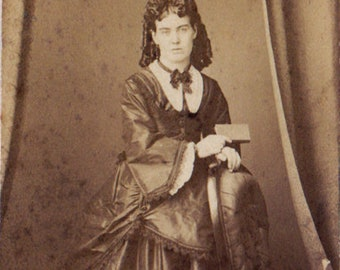 antique photograph - Card De Visite of an 1870s Victorian woman with ringlets posing with a book - Henry Jones Adelaide -Australian studio