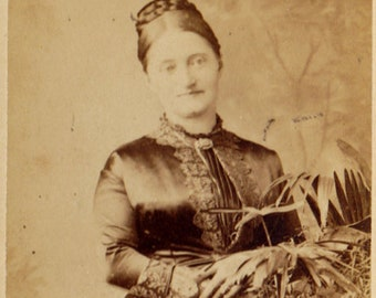 antique CDV photo - Victorian woman in satin dress with braided hair and a basket of plants - John Edwards Hyde Park London studio