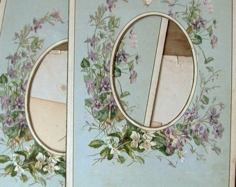 2 antique photograph album pages - Victorian oval frame board with lithograph florals in purple and blue - gilt edges