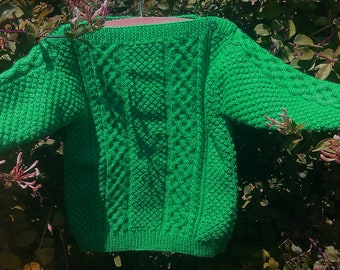 Child's toddlers boys girls handknit bright green emerald St Patricks Day aran cable sweater jumper with slash neckline. St Paddy Patty Day