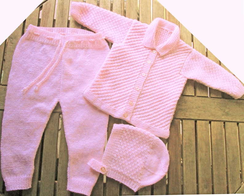 c0a7fd617e36 Baby infant girl hand knitted pale pink matinee outfit of