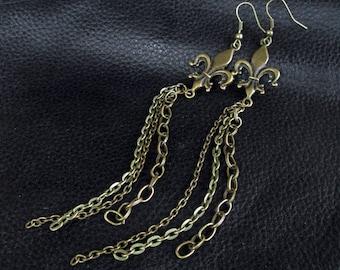 Statement tassel earrings, antique brass tone Fleur de Lis shoulder dusters