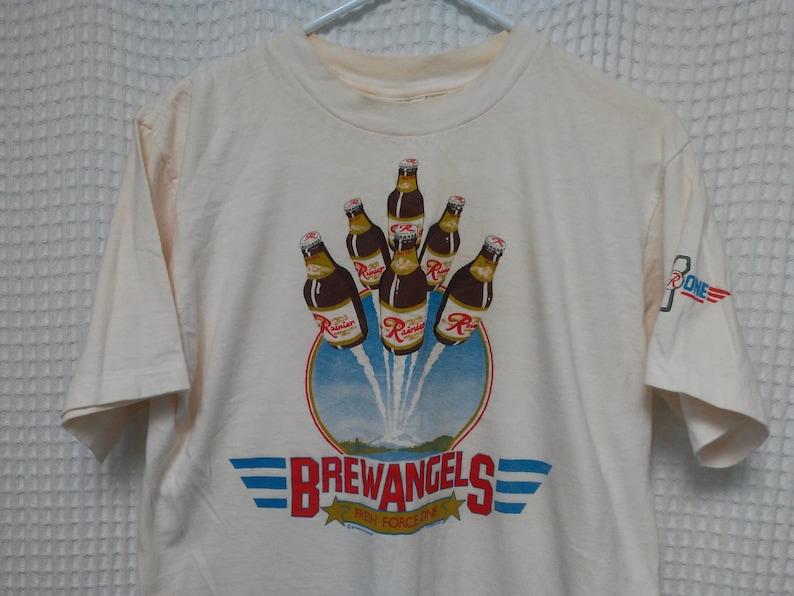 2c722051b vintage Rainier BEER T Shirt Brew Angels flying Bottles Mount Rainier Rare  Brewery artist single stitch tee Pop One Top Gun spoof 1980s M/L