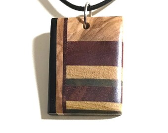 Social Distancing Wooden Pendant - Necklace made of reclaimed Olivewood, Bloodwood, Ebony, Yellowheart + scraps while at home in March 2020