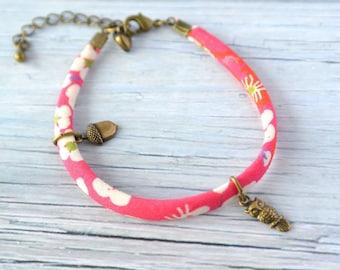 Woodland Bracelet with a tiny brass acorn and tiny owl on pink liberty ribbon
