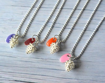 Woodland necklace with a tiny pine cone and pink enamel pendant / purple/burgundy/orange.