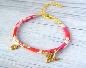 Woodland Bracelet with a tiny gold acorn and tiny owl on pink liberty ribbon