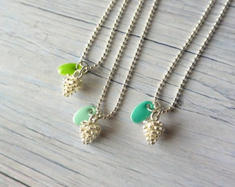 Woodland necklace with a tiny pine cone and green enamel pendant. Holiday's gift