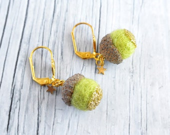Green earring with a tiny acorn with gold glitter and tiny star.