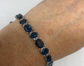Handmade Genuine Blue Topaz Rhodium Finished 925 Sterling Silver Tennis Bracelet