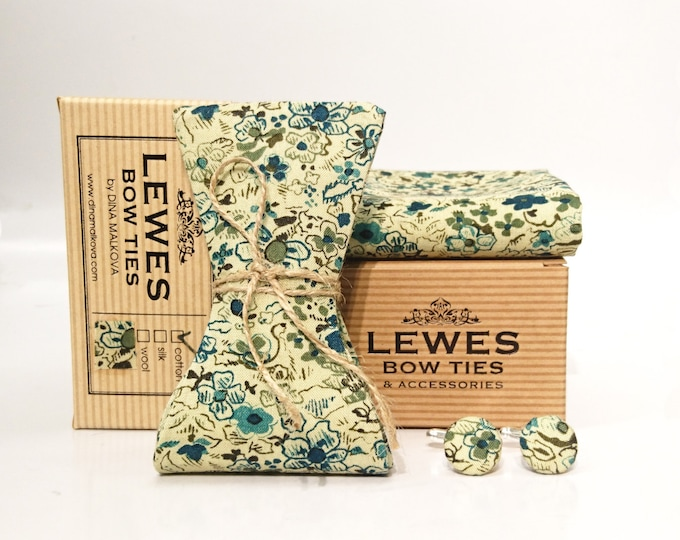 A set of green floral bow tie pocket square and a pair of cufflinks