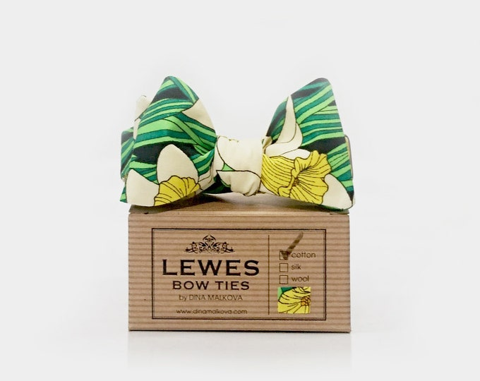 Men's self-tie bow tie made from bright green white and yellow cotton with charming daffodil print