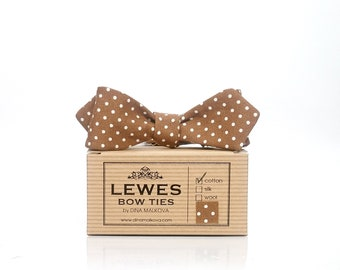 Skinny 50s style diamond point polka dot self tie bow tie made from brown vintage cotton with mini white dots