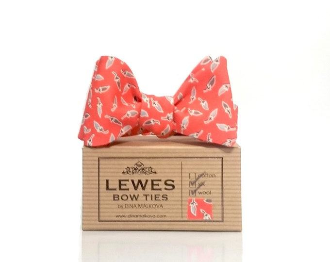 Coral self tie bow tie made from Japanese silk wool fabric with a mini chillies print