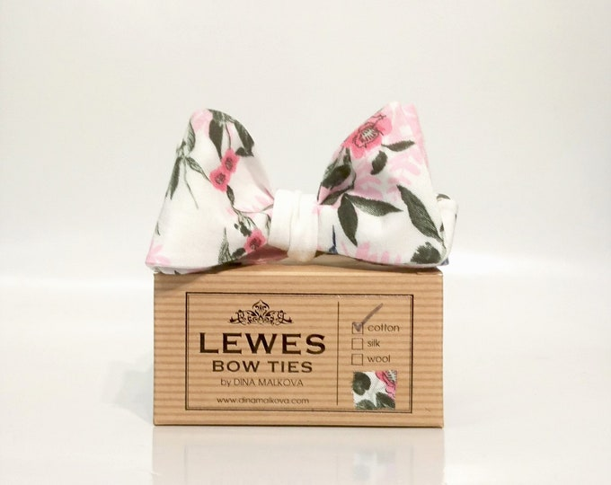 White and pink floral self tie bow tie with a hummingbird print