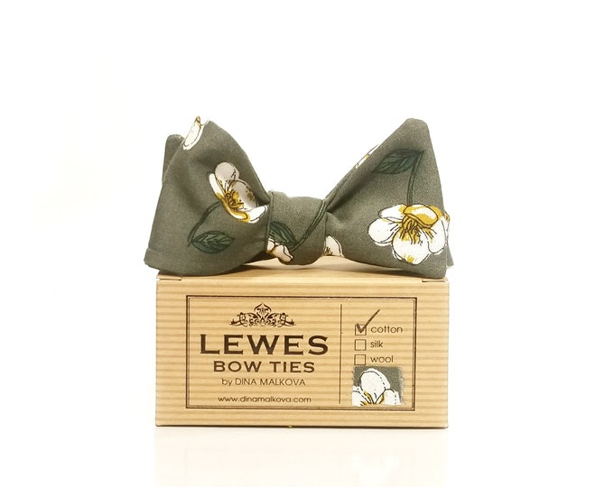 Ivory and mustard yellow flowers on moss green self tie bow tie made from vintage finest cotton fabric