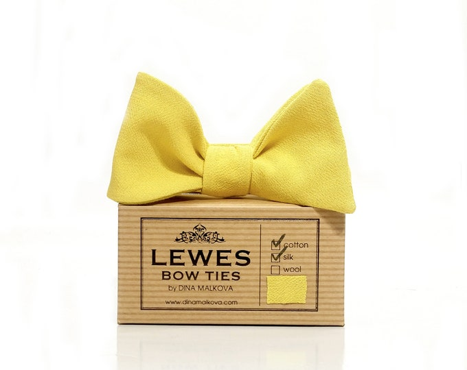 Mustard yellow textured silk and cotton self tie bow tie