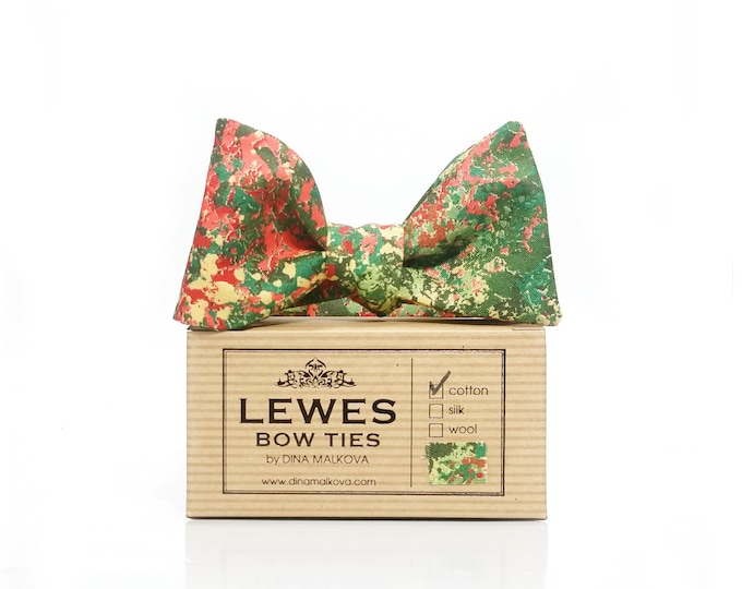 Green and coral abstract print self tie bow tie with a touch of mustard yellow.