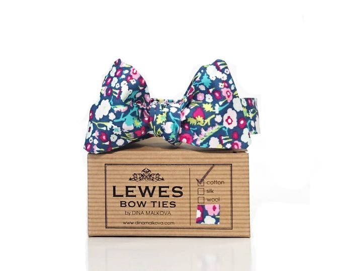 Floral self tie bow tie with blue pink flowers all over