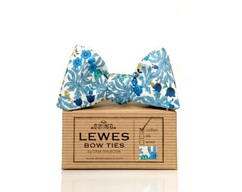 Floral navy blue and green with a touch of mustard yellow self tie bow tie made from vintage cotton fabric.