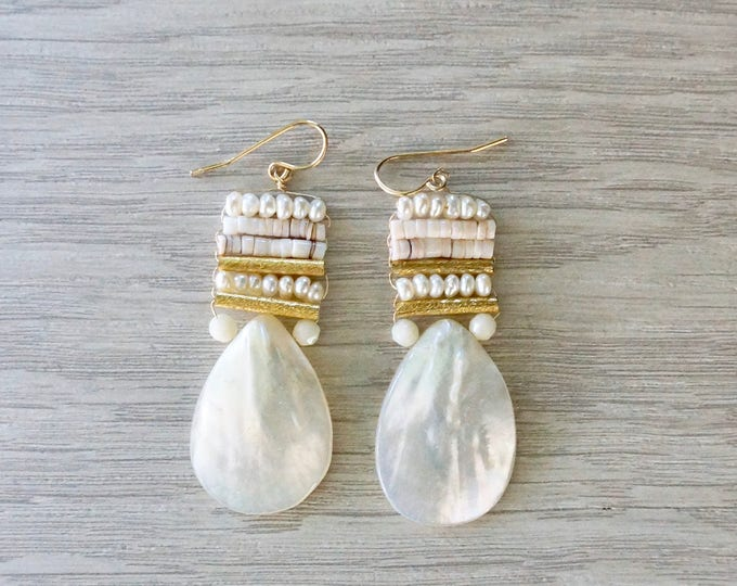 White beaded earrings