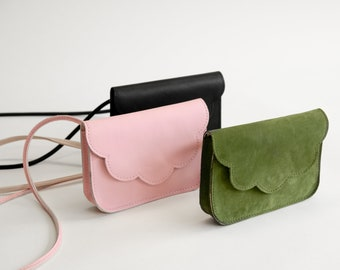 Small leather bag with shoulder strap and scalloped flap handmade in Montréal with upcycled materials