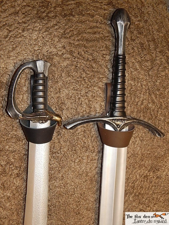 Universal ring holder for: axes maces swords daggers or anything that fits!