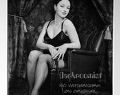 Seated pinup with crop, s...