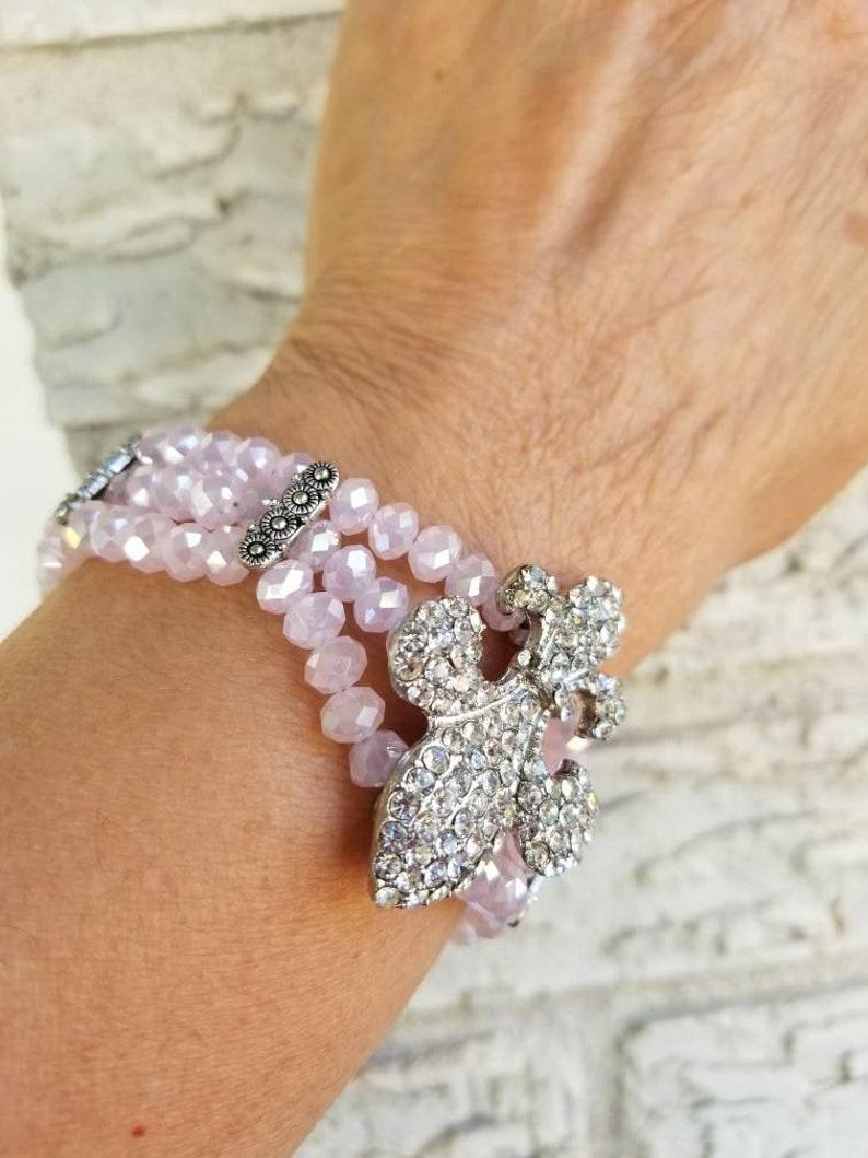 Pink Fleur de lis pink crystal bracelet 8in.
