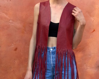 Vintage red leather fringe vest. hippie boho bohemian gypsy.  small medium