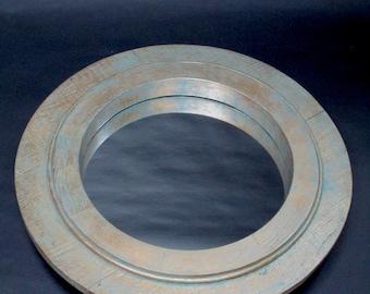Faux brass circular mirror