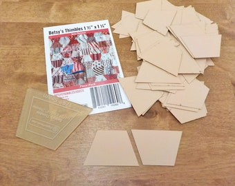 Betsy's Thimbles by Betsy Chutchian papers and template...1 1/2 x 1 1/4 inch thimble papers...80 pieces, laser cut
