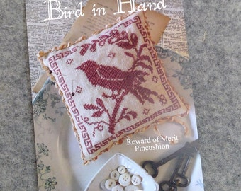 Bird in Hand, Reward of Merit Pincushion, by Blackbird Designs...cross-stitch design