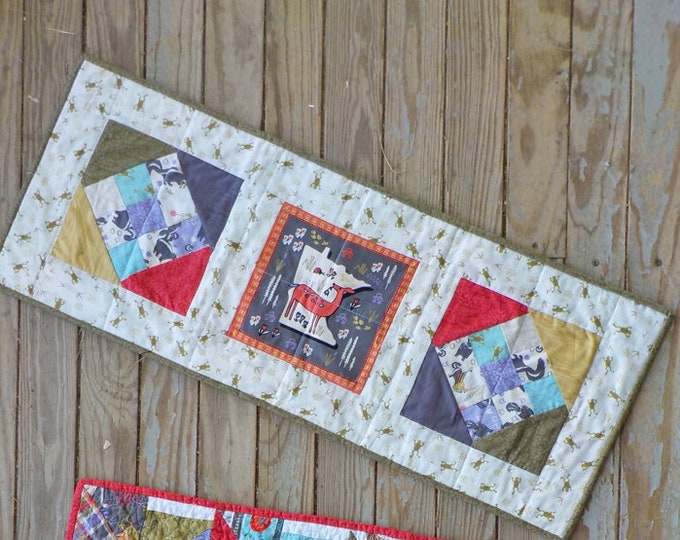 Frog Pond table runner kit featuring Quilt Minnesota 2018.....fabric designed by Teresa Magnuson for Clothworks