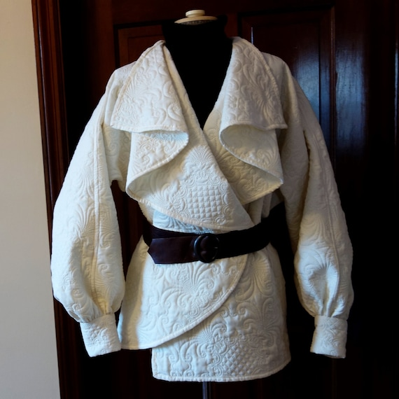 68e4fac7 Winter white ivory quilted jacket coat wrap front belted asymmetric draped  collar long sleeves cuffs futuristic star wars brown leather belt
