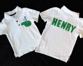 Front and back -Boy, toddler white  polo golf SHIRT with green and argyle blue flag and name on back in green applique