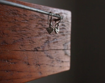 Tiny silver earrings. Tiny heart earrings. Silver heart earrings. Silver hearts.
