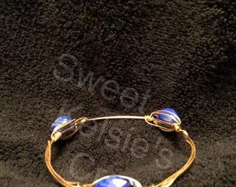Blue with whitish tent stone bangle