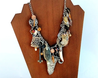 One of a Kind Assemblage Necklace in Silver, Cream and Amber with Agate, Glass, Pewter and Shell
